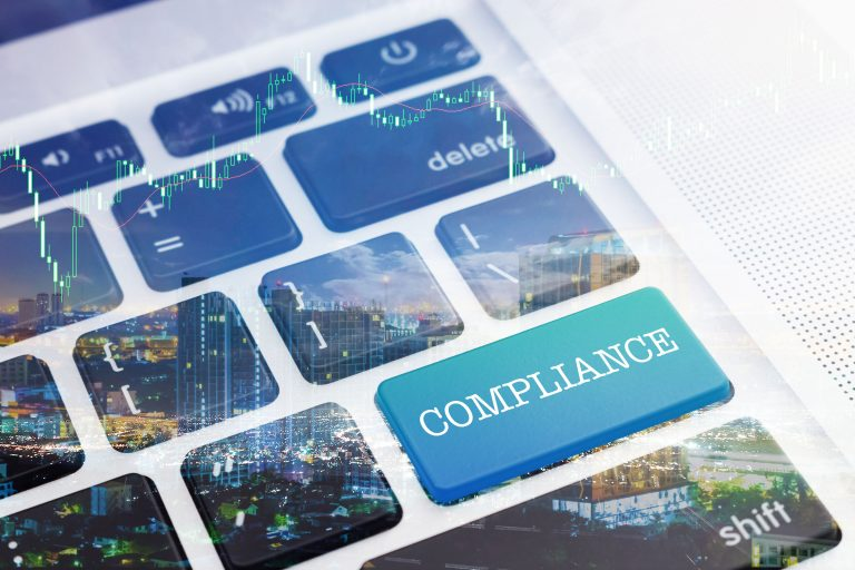 One of the keys on a computer keyboard displays the word 'compliance'.